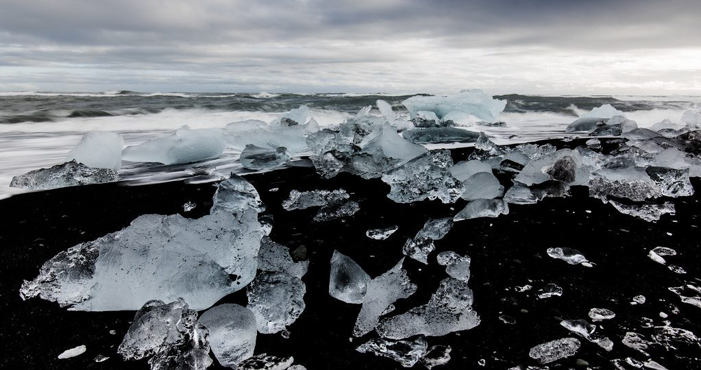 Black sand beach with icebergs that look like diamonds.