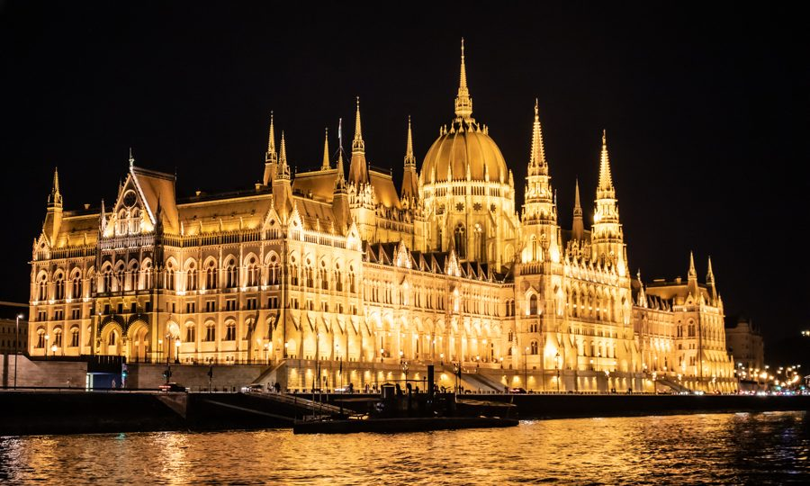 A magnificent night view of the Parliament Building from a dinner cruise on the Danube River.