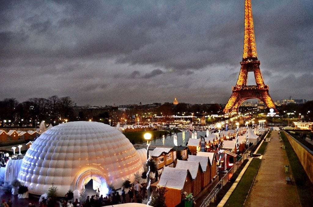 Paris Christmas Market with Eiffel Tower in the background.