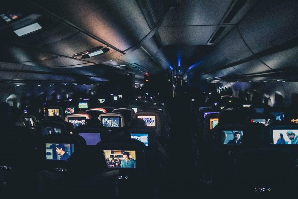 Dark in-flight cabin with some tv's working and some not working!