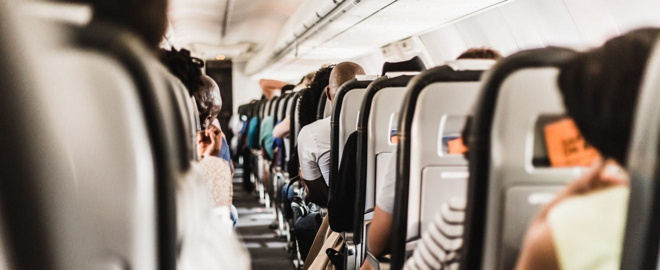 Photo on the aisle on a plane full of people!