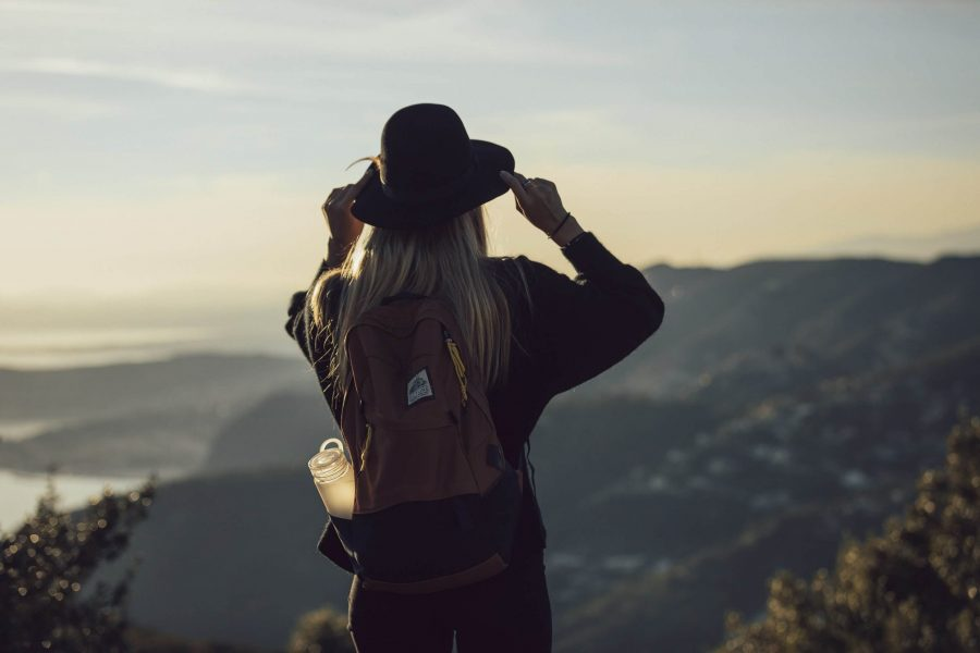 girl looking at views; planning a solo trip